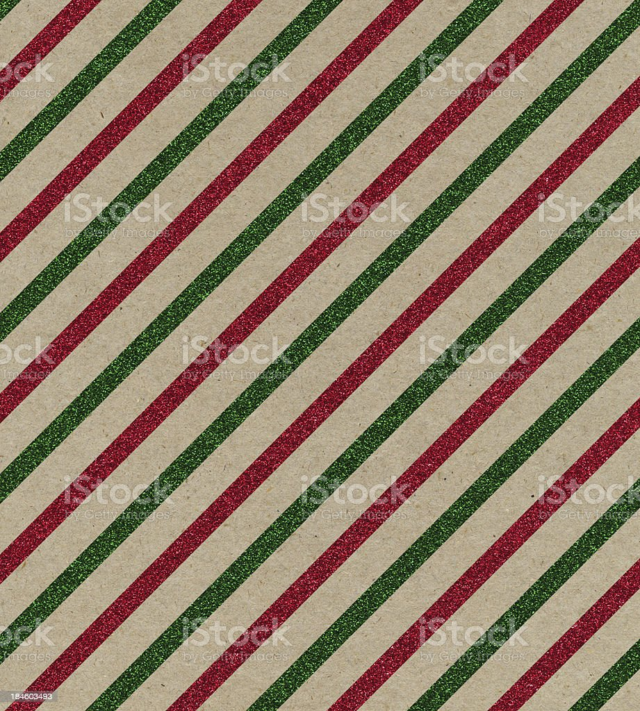 brown paper with red and green glitter stripes stock photo