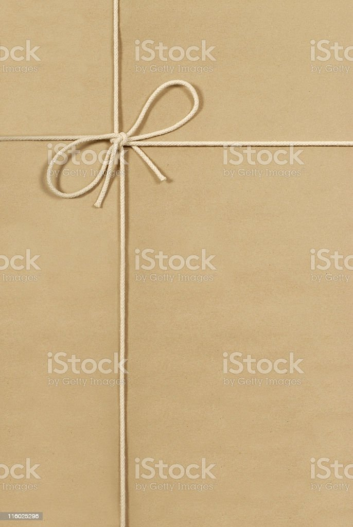 Brown parcel with cream cotton string royalty-free stock photo