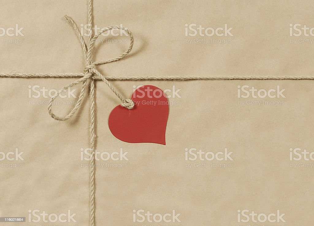 Brown parcel with rope and heart royalty-free stock photo
