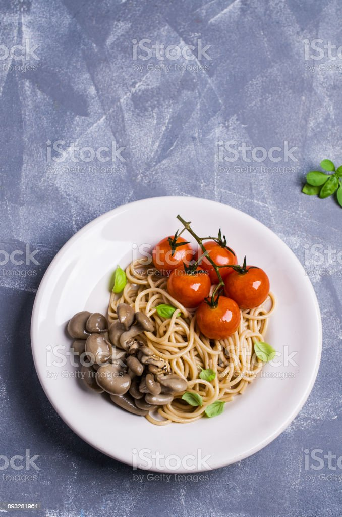 Brown pasta with vegetables stock photo