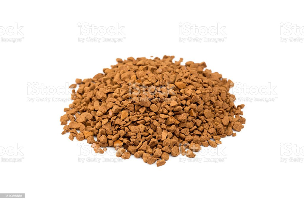 Brown pieces of instant coffee on white stock photo