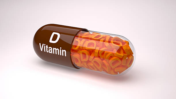Brown pill or capsule filled with vitamin D. stock photo