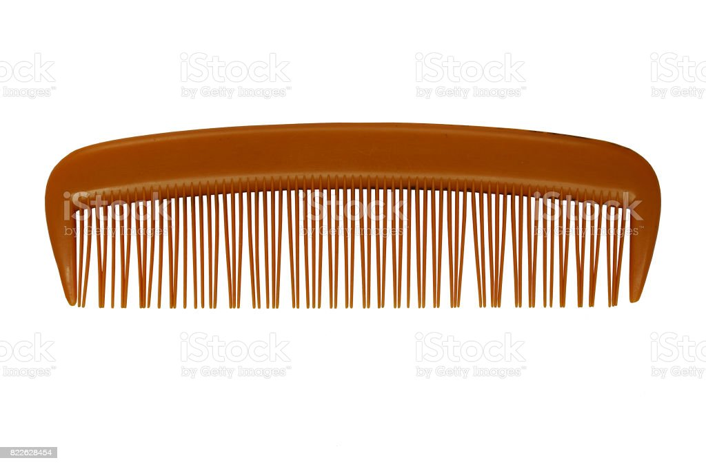 Brown Platic Comb Isolated On The White Background. stock photo