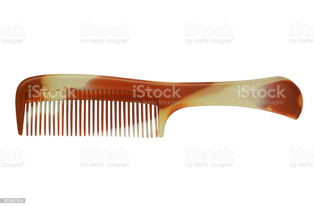 Brown Platic Comb Isolated On White Background. stock photo
