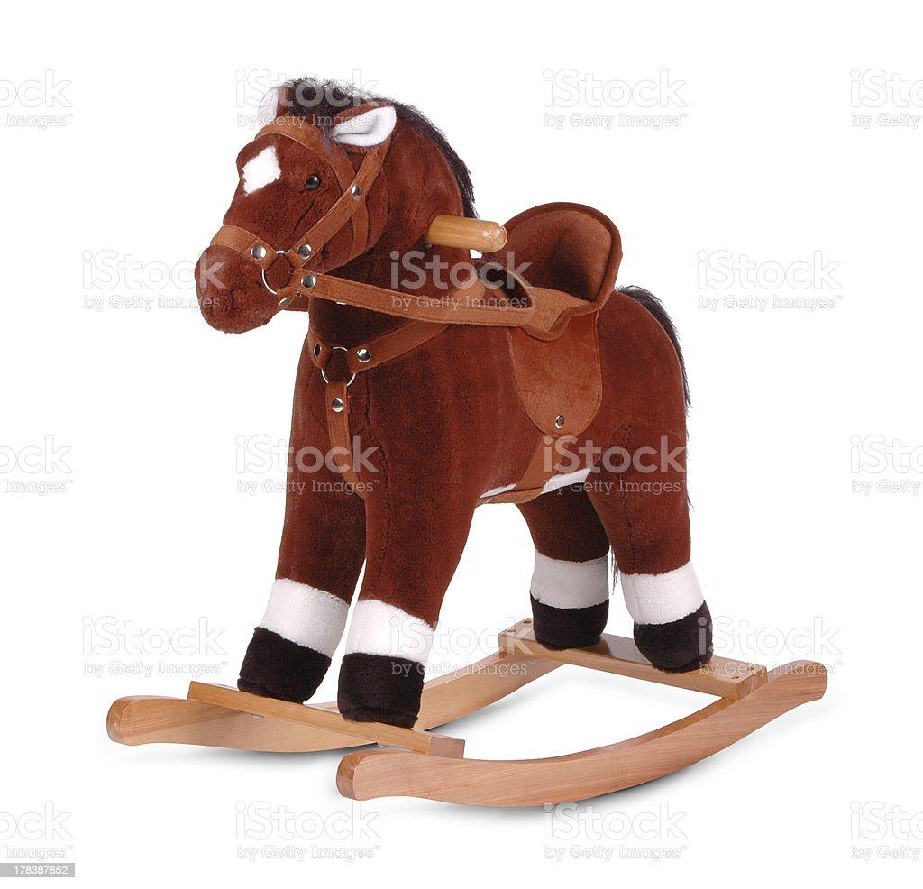 brown plush rocking horse stock photo