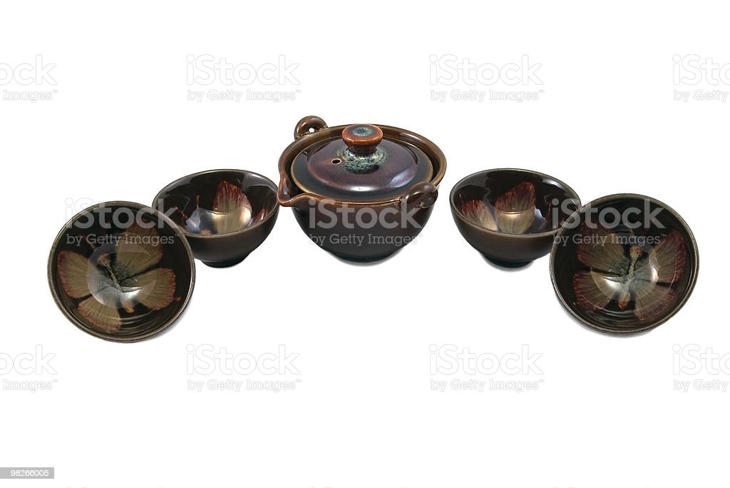 brown pot and four bowls with butterfly drawing royalty-free stock photo