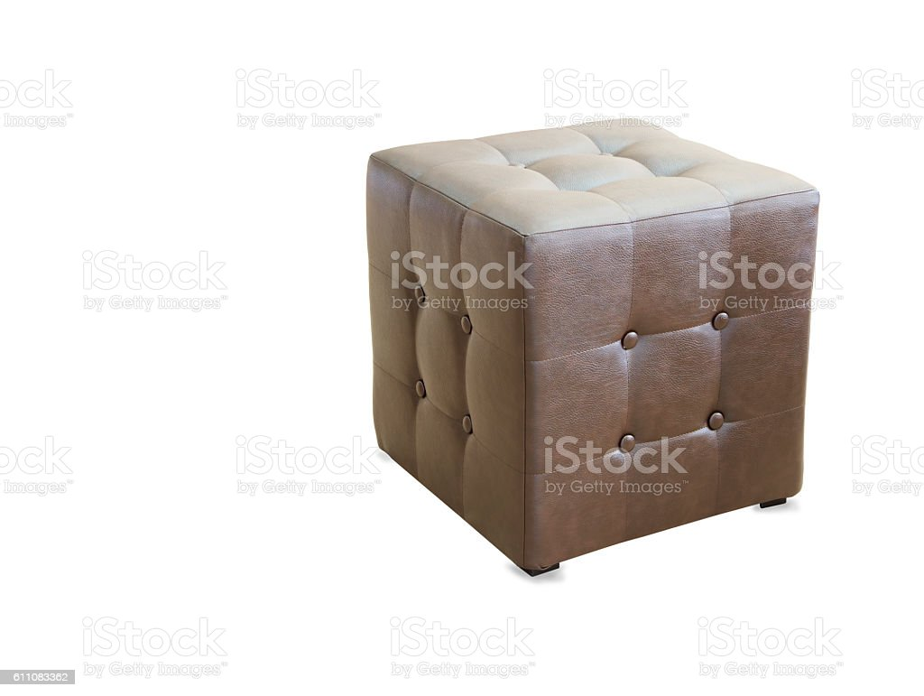 Brown pouf ottoman isolated over white stock photo