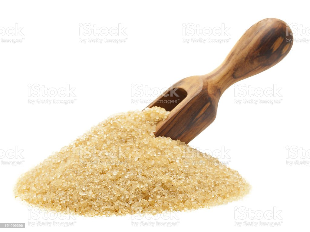 Brown raw cane sugar stock photo