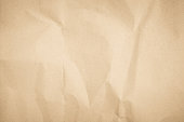 istock Brown recycled craft paper texture as background. Cream paper texture, Old vintage page or grunge vignette. Pattern rough art creased grunge letter. Hardboard with copy space for text. 1178879402