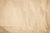 istock Brown recycled craft paper texture as background. Cream paper texture, Old vintage page or grunge vignette. Pattern rough art creased grunge letter. Hardboard with copy space for text. 1182999979