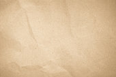 istock Brown recycled craft paper texture as background. Cream paper texture, Old vintage page or grunge vignette. Pattern rough art creased grunge letter. Hardboard with copy space for text. 1184951270