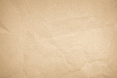 istock Brown recycled craft paper texture as background. Cream paper texture, Old vintage page or grunge vignette. Pattern rough art creased grunge letter. Hardboard with copy space for text. 1187244147