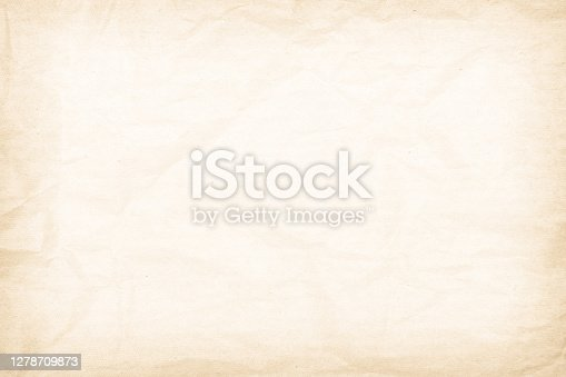 Brown recycled paper crumpled texture background. Cream Old vintage page or grunge vignette parchment old blank newspaper. Pattern empty rough cardboard creased grunge surface backdrop with space.