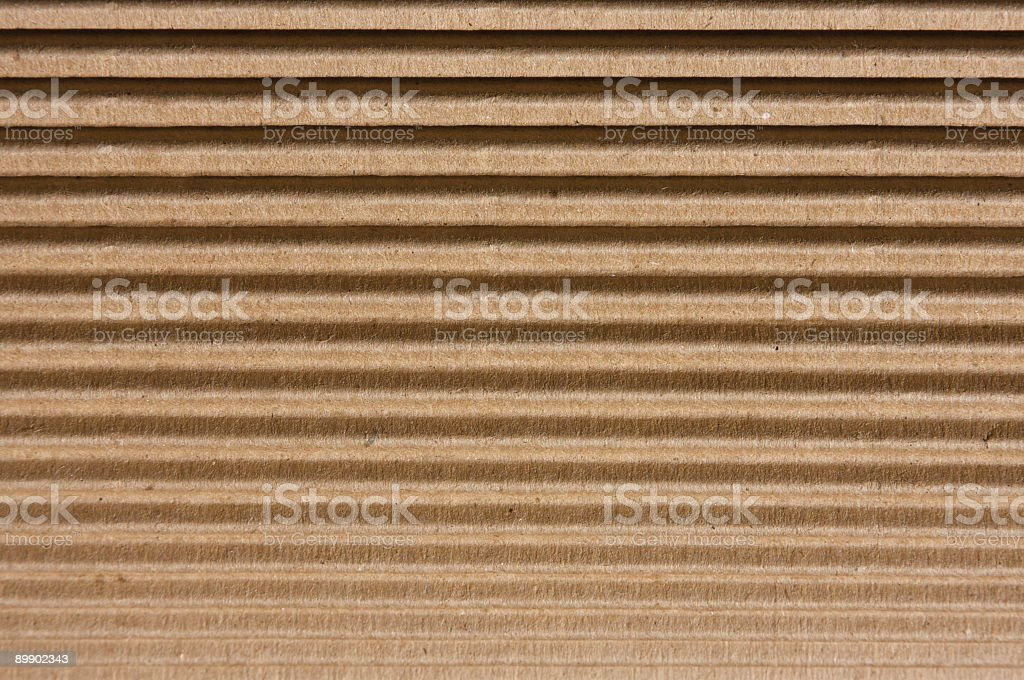 Brown Ribbed Corrugated Cardboard Background royalty free stockfoto