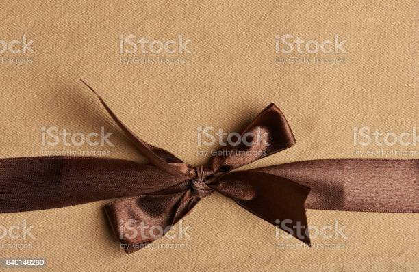 Brown ribbon on yellow background picture id640146260?b=1&k=6&m=640146260&s=612x612&h=0lago6l6 x7s4aioriumcwwwsptag3p7c1bd2lnkdks=