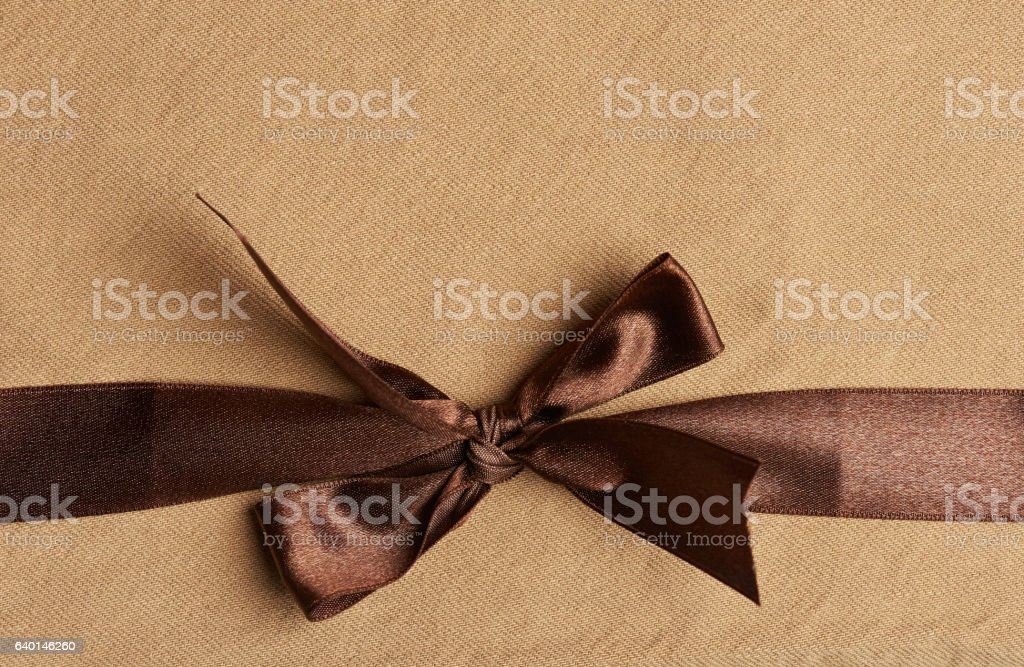 Brown ribbon on yellow background stock photo