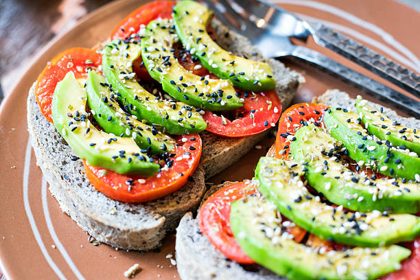 Brown rice bread sandwich with avocado stock photo