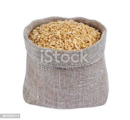 istock Brown rice in bag isolated on white background 904936314