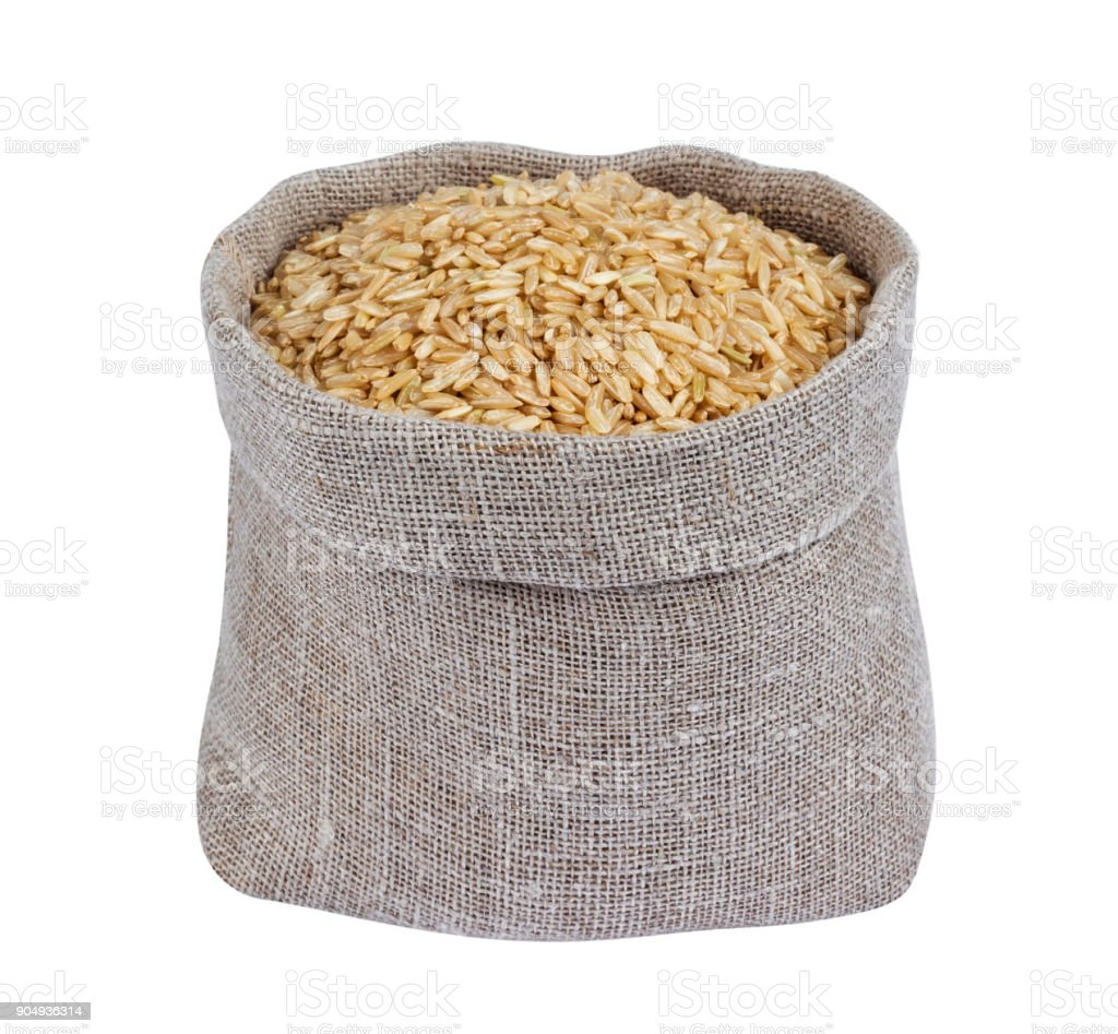 Brown rice in bag isolated on white background stock photo