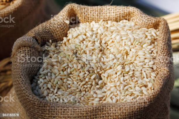 Brown Rice In Bag Stock Photo - Download Image Now