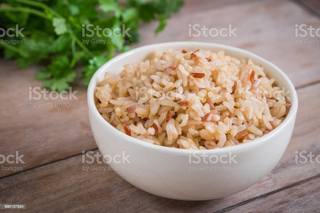 Brown rice in bowl stock photo
