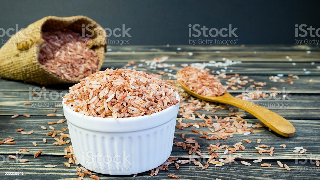 Brown rice in white cup stock photo