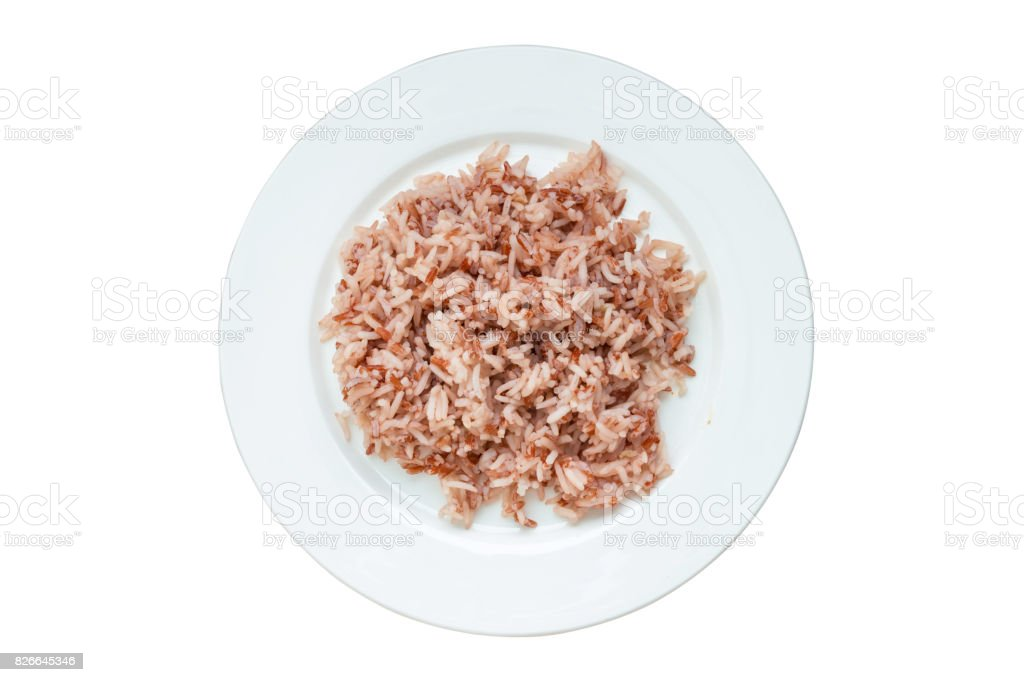 Brown rice in white plate ready to eat, isolated on white background with clipping path stock photo