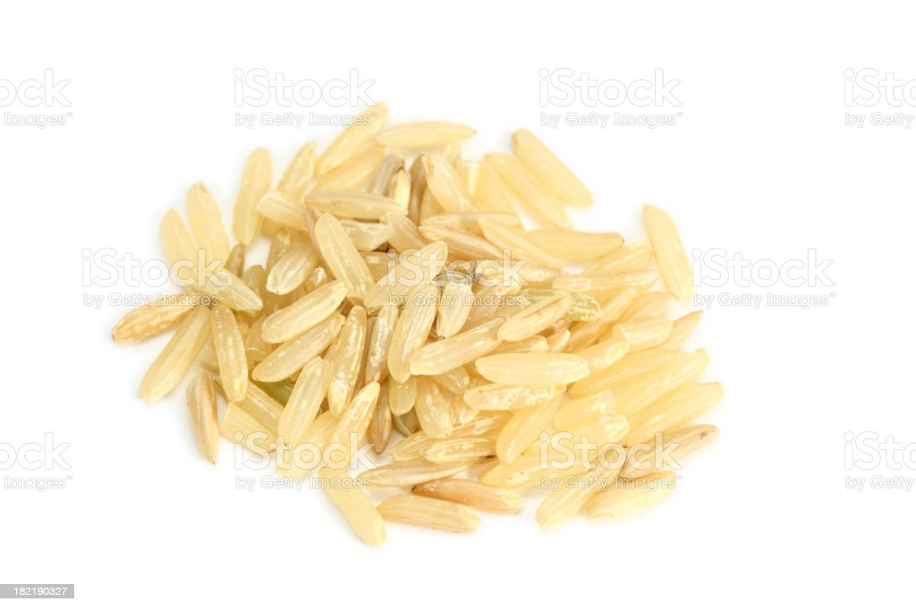 brown rice isolated on white stock photo
