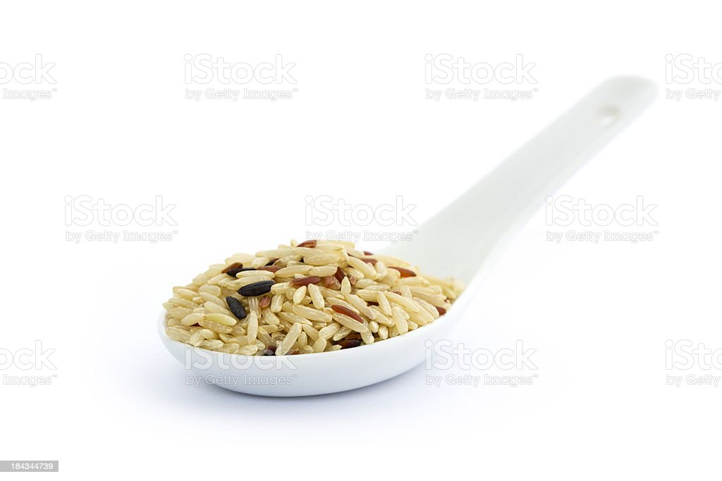 Brown rice on white spoon royalty-free stock photo