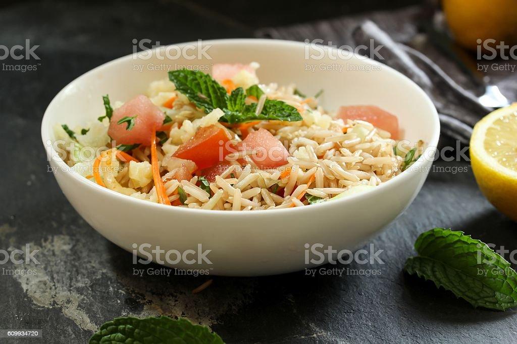 Brown rice salad / Rice salad selective focus stock photo