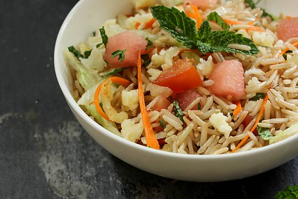 Brown rice salad / Rice salad selective focus stock photo