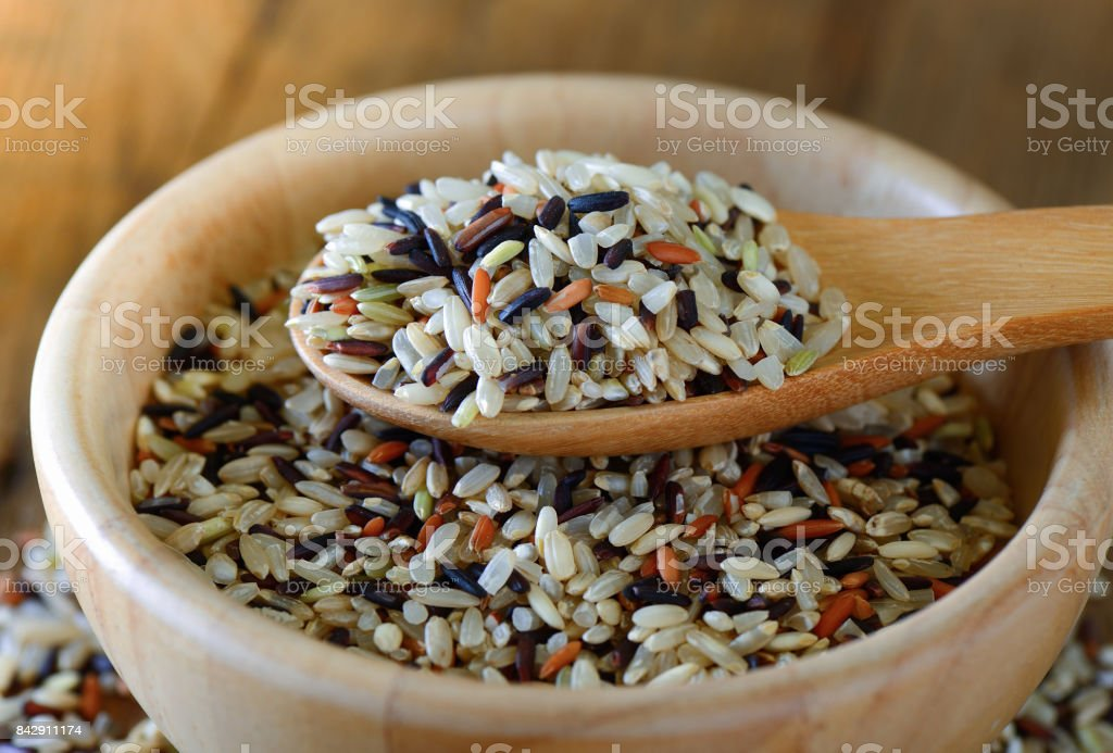Brown rice seed in spoon stock photo
