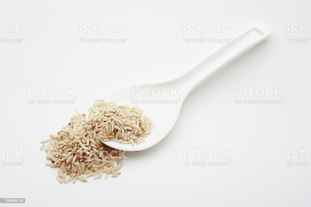 Brown Rice & Spoon royalty-free stock photo