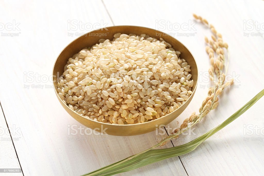 brown rice with ear of rice stock photo