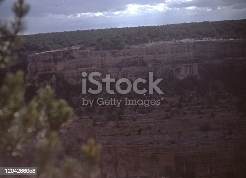 Vernacular photograph taken on a 35mm analog film transparency, believed to depict brown rock formation under blue sky during daytime, 1965. Major topics/objects detected include Escarpment, Sky, Canyon, Rock, Landscape, Cliff, Valley and Nature. (Photo by Smith Collection/Gado/Getty Images)