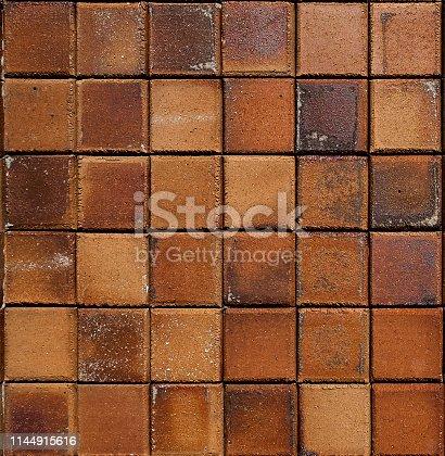 Close up shot of brown rustic floor tiles texture