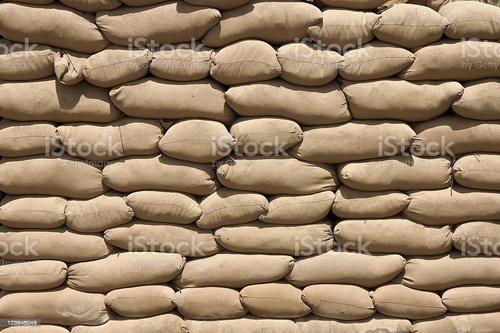 Brown Sand Bags in Harsh Direct Desert Sun stock photo