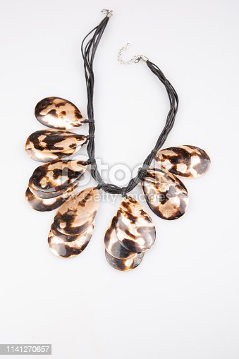Handmade necklace made with sea shells on white background