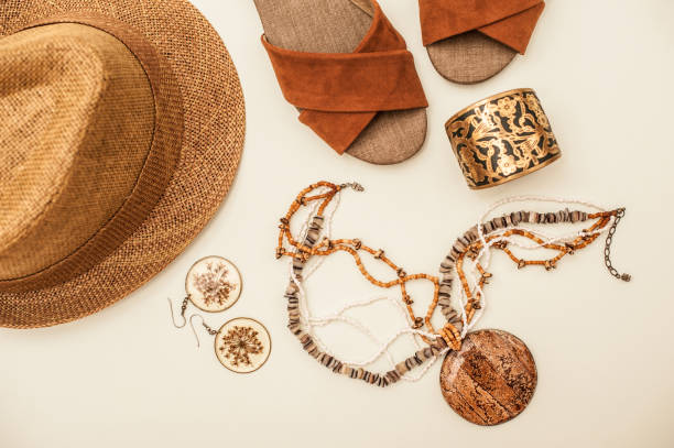 Brown Sandals, Necklace, Straw Hat and Earrings Isolated on White stock photo