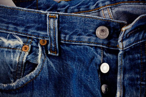 braune Naht Denim und Silber Taste Jeans und auf die alte blaue Jeans Denim Textur hautnah – Foto