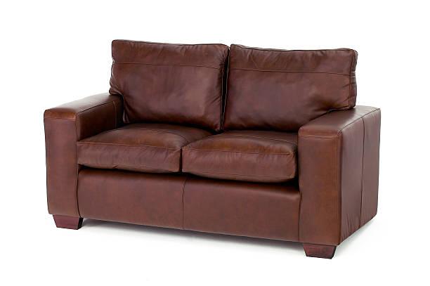 braun sofa, isoliert auf weiss - ledersessel braun stock-fotos und bilder