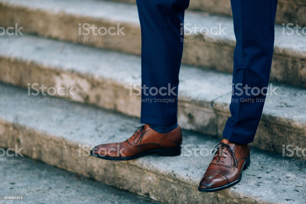 Brown shoes on male legs stock photo