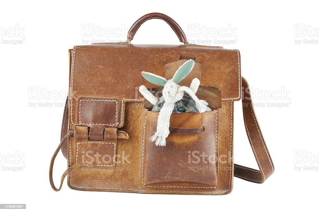 brown shoulder bag with cute toy rabbit in pocket stock photo