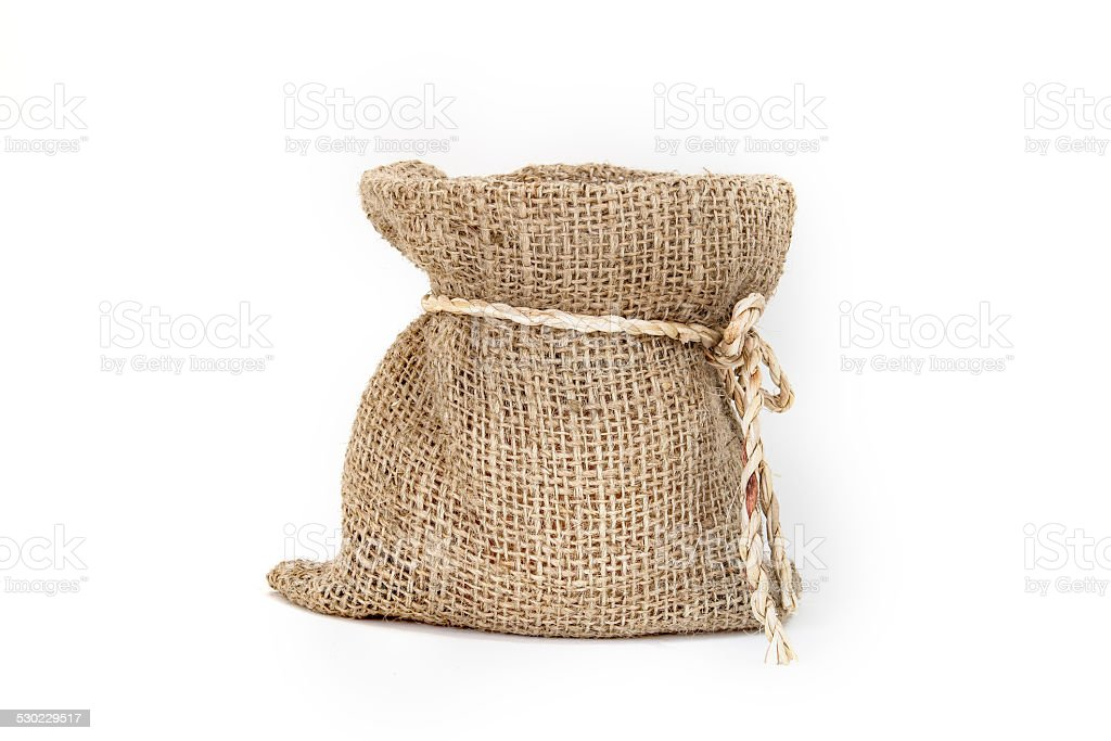 Brown small burlap bag with bow rope on white background stock photo