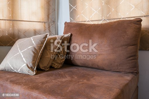 istock Brown Sofa Furniture with many pillows 616004536