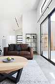 Brown leather scandi sofa in contemporary styled living room