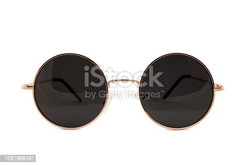 Street style oval sunglasses with thin golden metal frame, clear brown lens, isolated on white background, front view.