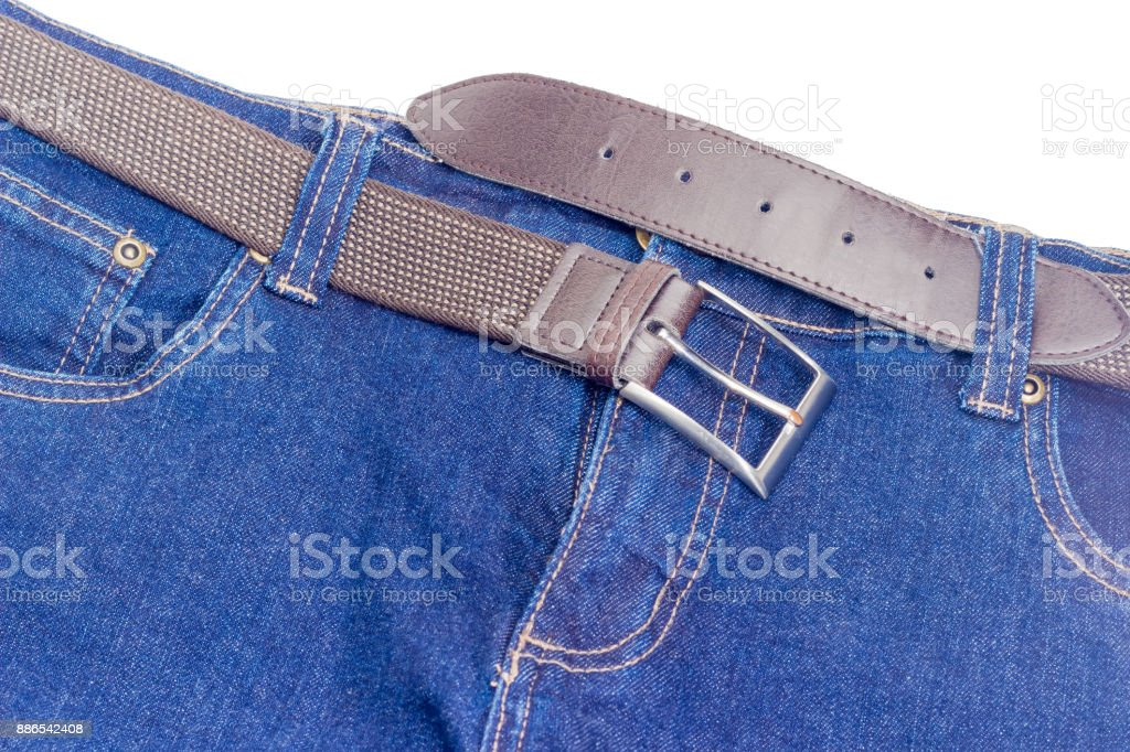 Brown stretch belt in belt loops of the blue jeans stock photo