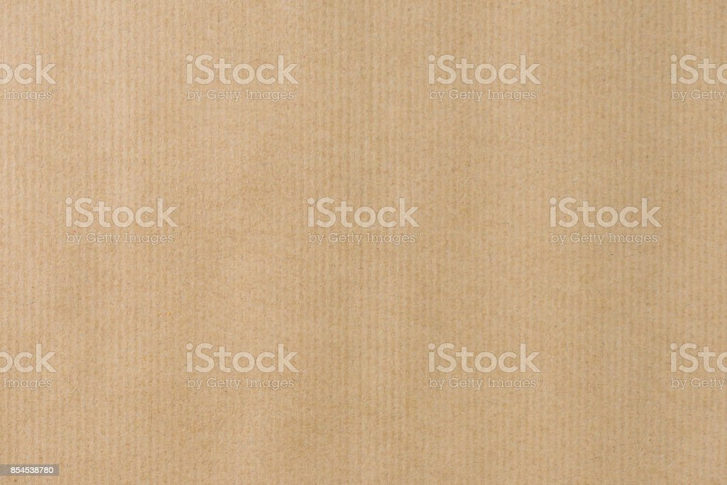 Brown striped recycle paper texture for wraping. Kraft paper royalty-free stock photo