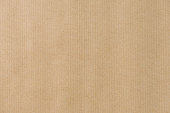 istock Brown striped recycle paper texture for wraping. Kraft paper 854538780